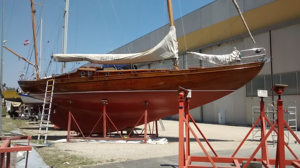 Marianne on the hard exposing her varnished hull and fetching lines