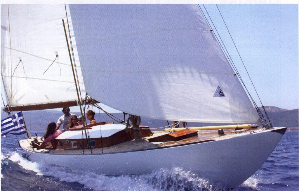 Slana sailing in 1959, white sails, teak deck, sunshine and sea