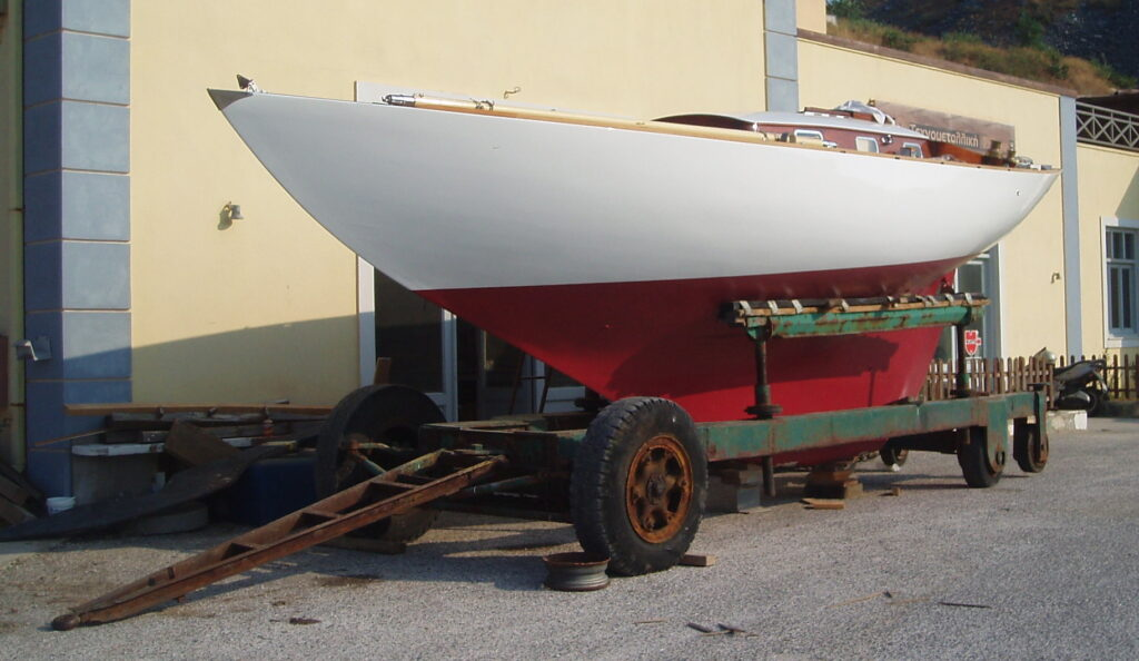 Salana hull on an old trailer showing traditional keel